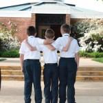 Three boys entering church